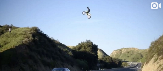 Dirt Bike Flying Over Freeway