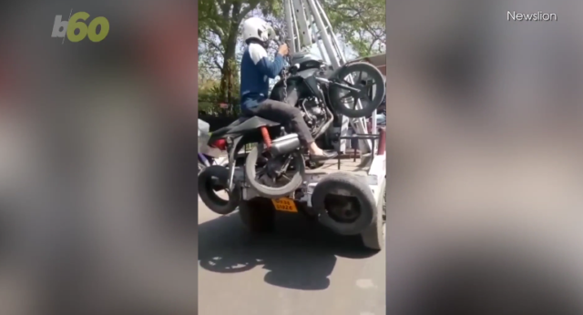 Motorcycle Gets Towed With The Driver Still On It