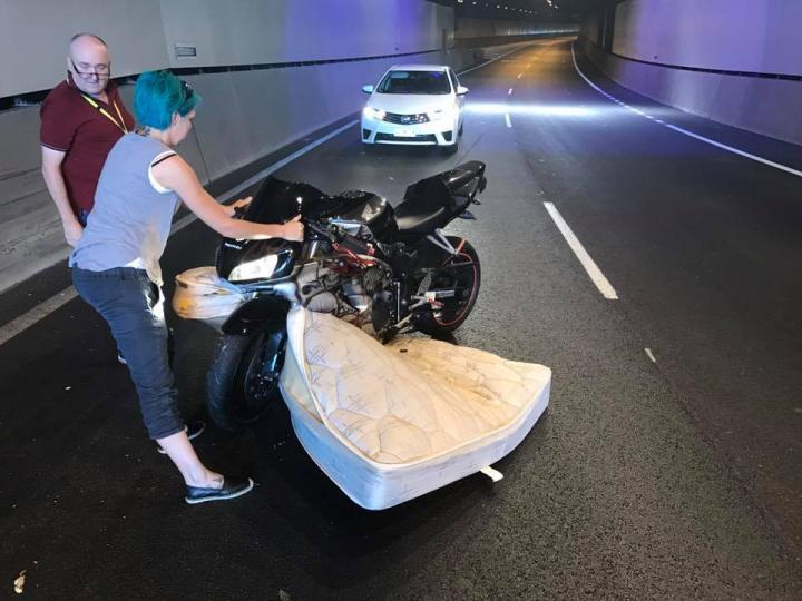 Motorcyclist struck by a mattress